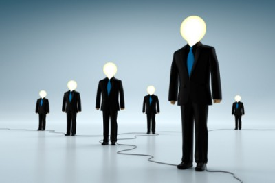 Light bulb head business people standing together
