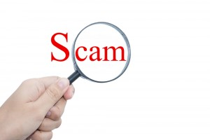 magnifying-glass-over-the-word-scam